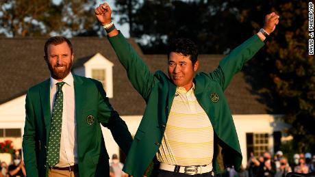 Matsuyama puts on the champion's Green Jacket after winning the Masters.