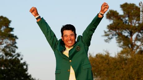 Matsuyama celebrates after putting on the champion's green jacket after winning the Masters.