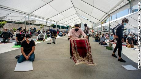 Men attend socially distanced outdoor prayers in Culver City, California.