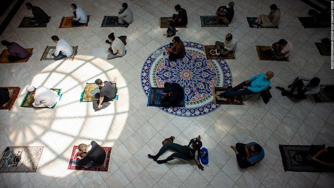Men space out their prayer rugs during prayers at King Fahad Mosque in Culver City, California.