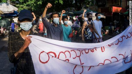 Protesters march during a demonstration against the military coup in Yangon on April 11, 2021.