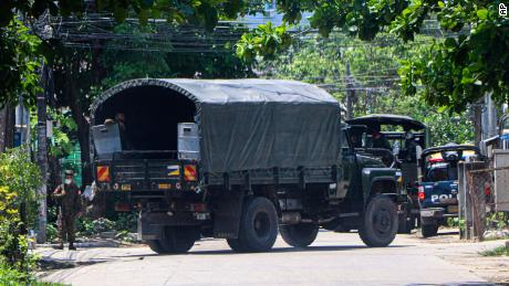 A police vehicle is parked at a road in South Okkalapa township to block anti-coup protesters' gathering in Yangon, Myanmar, Friday, April 9, 2021.
