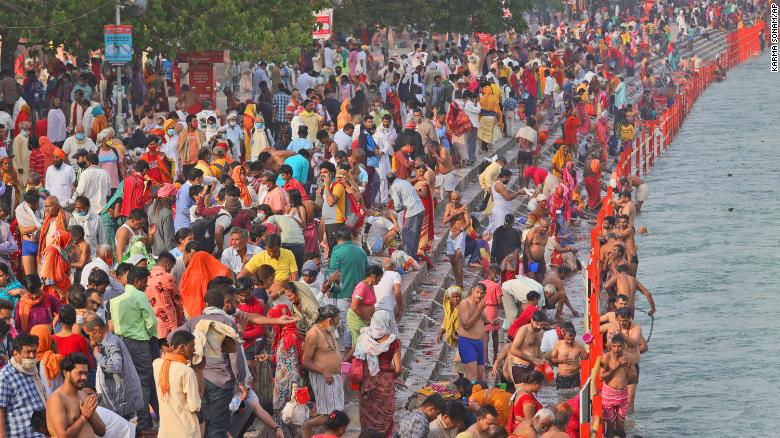 Millions of Hindu pilgrims head to the Ganges River as India's daily coronavirus cases continue to surge
