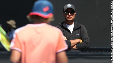 Lleyton Hewitt watches his son Cruz play in the 12 & Under 2019 Australian Open.
