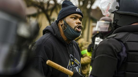 A protester confronts a police officer during a rally on Monday.