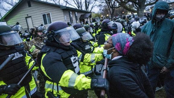 Another protester confronts police in Brooklyn Center.