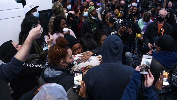 People embrace Wright's mother, Katie, as protesters gathered on Sunday.