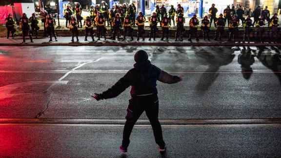 A demonstrator taunts authorities on Monday.