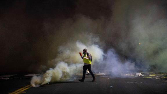 Protesters clash with police on Sunday.