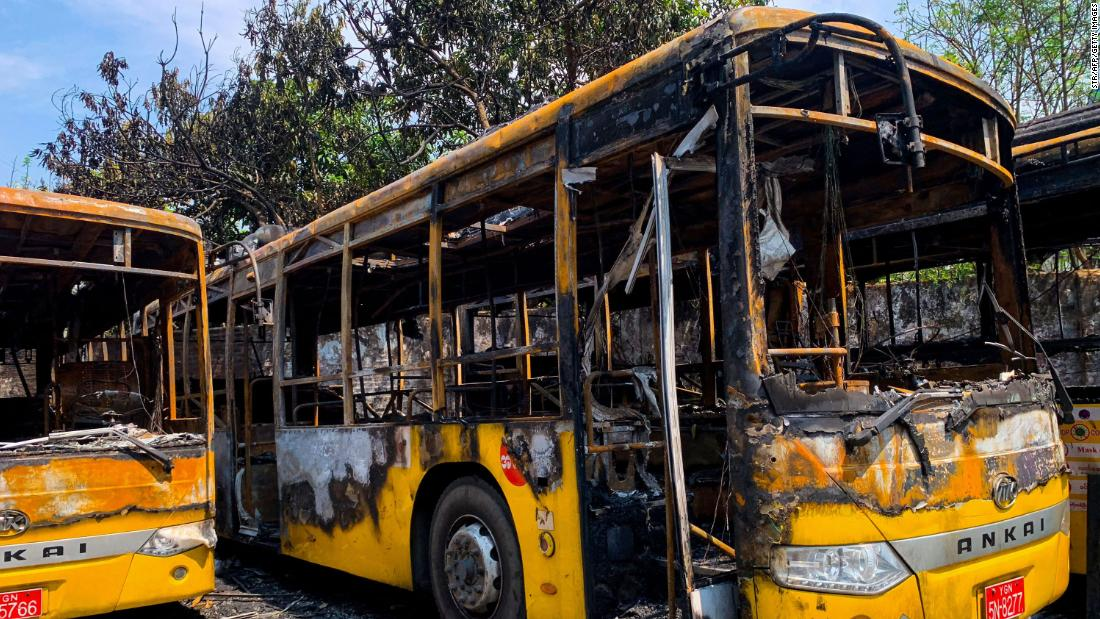 Buses from the Yangon Bus Service are seen burnt on April 12.