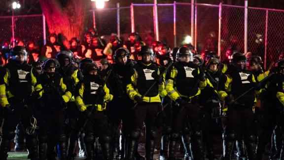 Authorities advance on demonstrators gathered outside the Brooklyn Center Police Department on Tuesday.