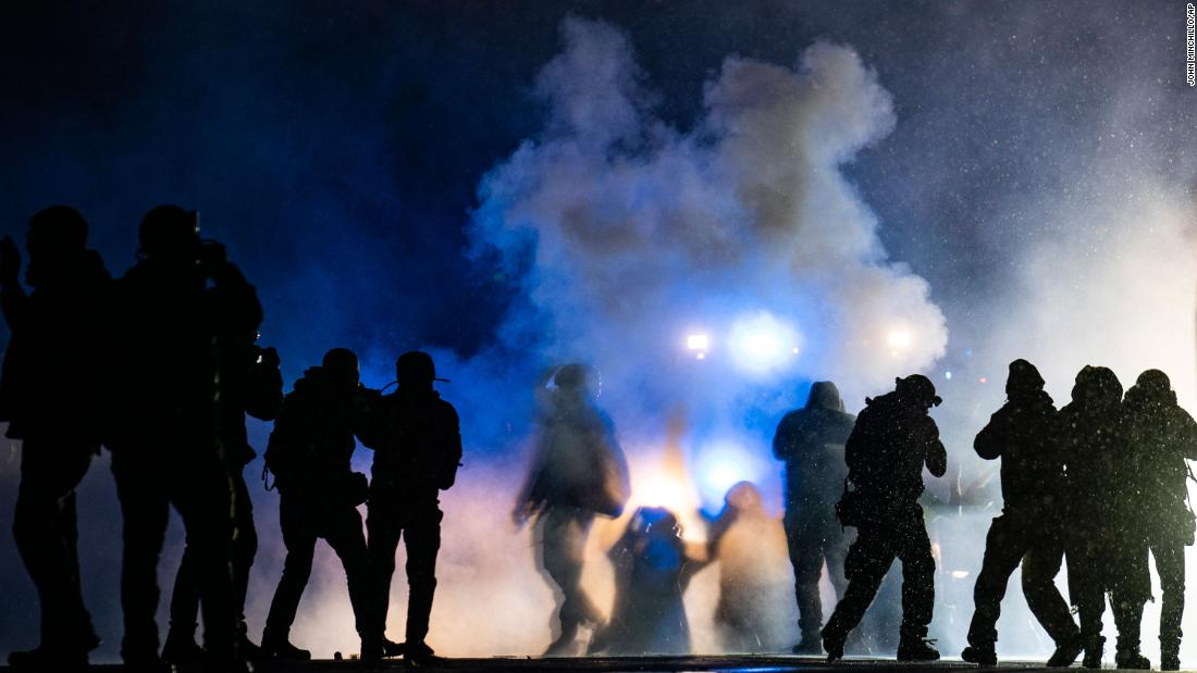 Daunte Wright shooting: Protesters and police clash for a third night in a Minneapolis suburb as prosecutors weigh charges against officer
