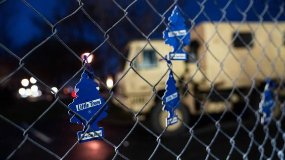 Demonstrators hang car air fresheners from a perimeter fence outside the Brooklyn Center Police Department to protest the shooting death of Daunte Wright, late Tuesday, April 13, 2021, in Brooklyn Center, Minn. (AP Photo/John Minchillo)