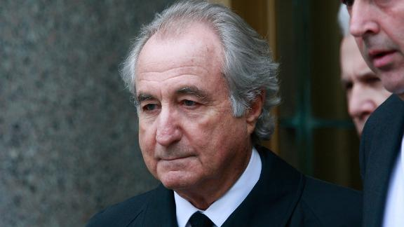 Accused $50 billion Ponzi scheme swindler Bernard Madoff exits federal court March 10, 2009 in New York City. Madoff was attending a hearing on his legal representation and is due back in court Thursday.  (Photo by Mario Tama/Getty Images)