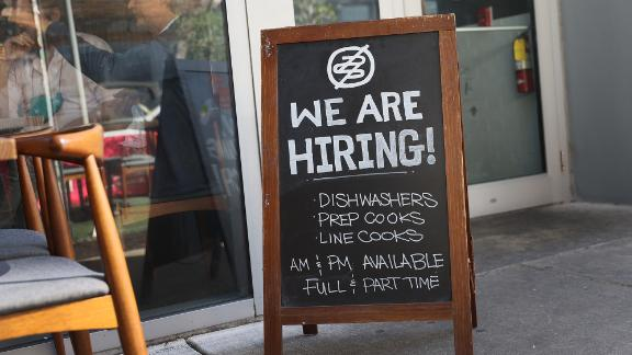 A 'we are hiring sign' in front of the Buya restaurant on March 05, 2021 in Miami, Florida. The restaurant is looking to hire more workers as the U.S. unemployment rate drops to 6.2 percent, as many restaurants and bars reopen. Officials credit the job growth to declining new COVID-19 cases and broadening vaccine immunization that has helped more businesses reopen with greater capacity. (Photo by Joe Raedle/Getty Images)