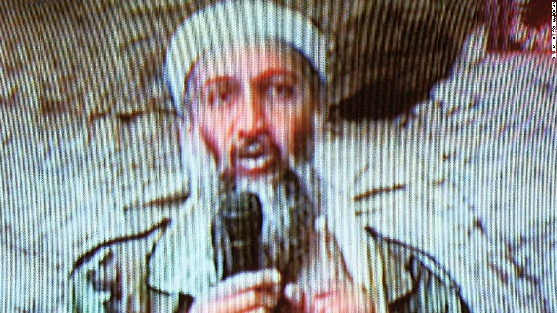"Al Qaeda leader Osama bin Laden is seen at an undisclosed location in this television image broadcast on October 7, 2001. Bin Laden praised God for the September 11 attacks and swore America ""will never dream of security"" until ""the infidel's armies leave the land of Muhammad."""