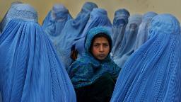 KALAKAN,  AFGHANISTAN - FEBRUARY 23:  Afghan women wait in line to be treated at the Kalakan health clinic February 23,2003 in Kalakan, Afghanistan.  (Photo by Paula Bronstein/Getty Images)
