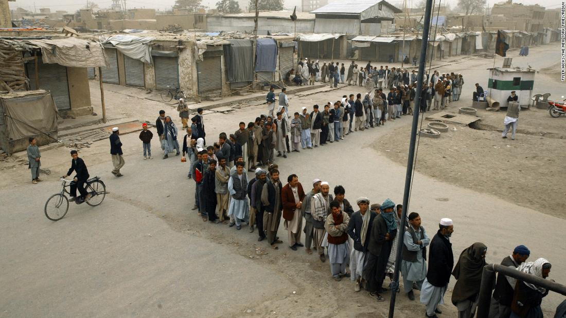 Afghans in Kabul line up to vote in the country's first democratic election in October 2004. Hamid Karzai was sworn in as President in December of that year.