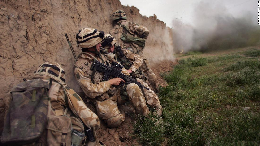 British Marines take cover during an anti-Taliban operation near Kajaki, Afghanistan, in March 2007. Many other countries also deployed troops to the country.
