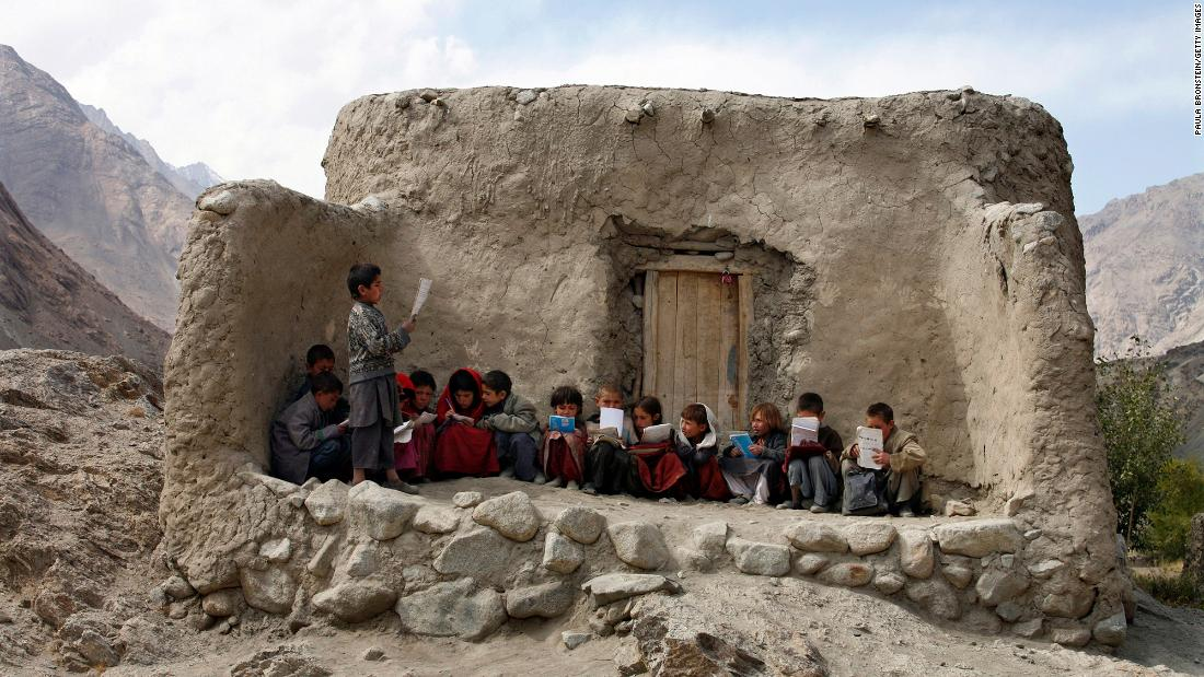 Afghan students recite Islamic prayers at an outdoor classroom in the remote Wakhan Corridor in September 2007.