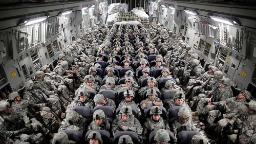 FILE -- American soldiers aboard a C-17 transport headed to Afghanistan, April 5, 2010. The United States and the Taliban are closing in on a deal to end America's longest war after six days of some of the most serious Afghan peace negotiations to date wrapped up on Jan. 26, 2019. (Damon Winter/The New York Times)
