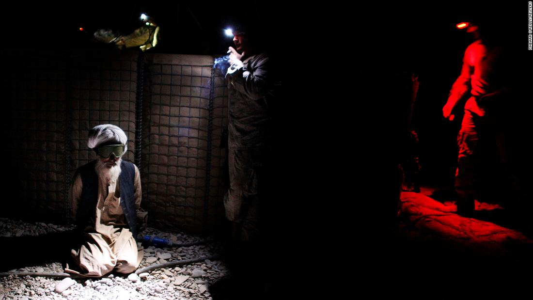An Afghan man is detained by US Marines after they battled Taliban insurgents in Afghanistan's Helmand province in November 2010.