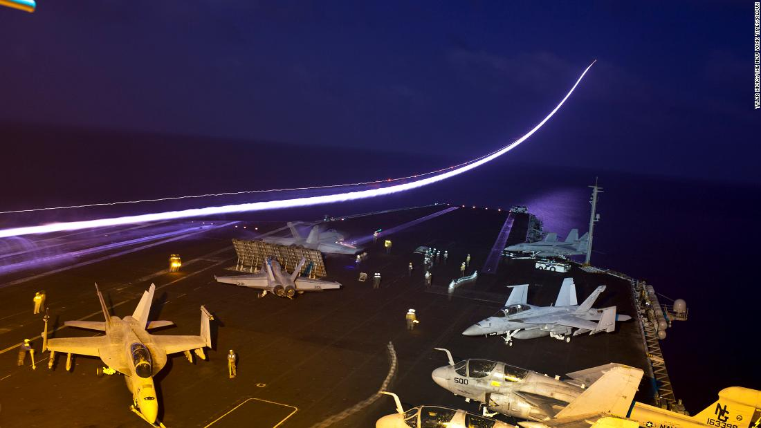 In this long-exposure photo, a jet takes off from the flight deck of the USS John C. Stennis, an aircraft carrier that was in the northern Arabian Sea in January 2012.