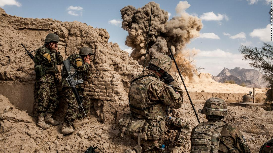Afghan soldiers, left, and American troops blow up a Taliban firing position in the Afghan village of Layadira in February 2013.