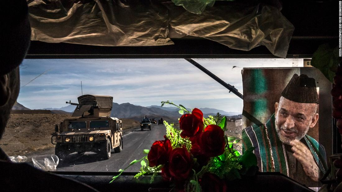 An Afghan army convoy travels Highway 1 in Afghanistan's Wardak province in November 2013. The picture at right shows Afghan President Hamid Karzai.