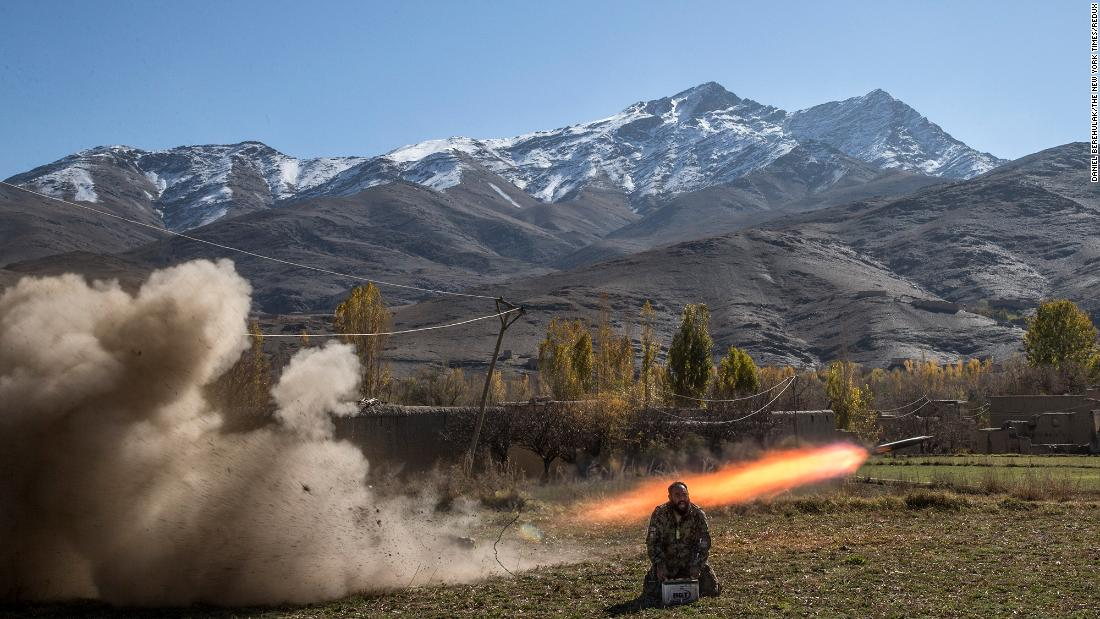 Afghan Army Sgt. Sayed Wazir screams a prayer while firing a rocket in Afghanistan's Wardak province in November 2013.