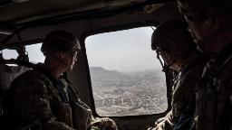KABUL, AFGHANISTAN - SEPTEMBER 5: American service members deployed for Mission Resolute Support ride in a helicopter over Kabul on the way to Bagram Air Field on September 5, 2017 in Kabul, Afghanistan. Currently the United States has about 11,000 troops in the deployed in Afghanistan, with a reported 4,000 more expected to arrive in the coming weeks. Last month, President Donald Trump announced his plan for Afghanistan which called for an increase in troop numbers and a new conditions-based approach to the war, getting rid of a timetable for the withdrawal of American forces in the country. (Photo by Andrew Renneisen/Getty Images)