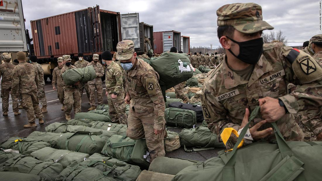 US soldiers retrieve their bags in Fort Drum, New York, in December 2020, after returning home from a nine-month deployment to Afghanistan.