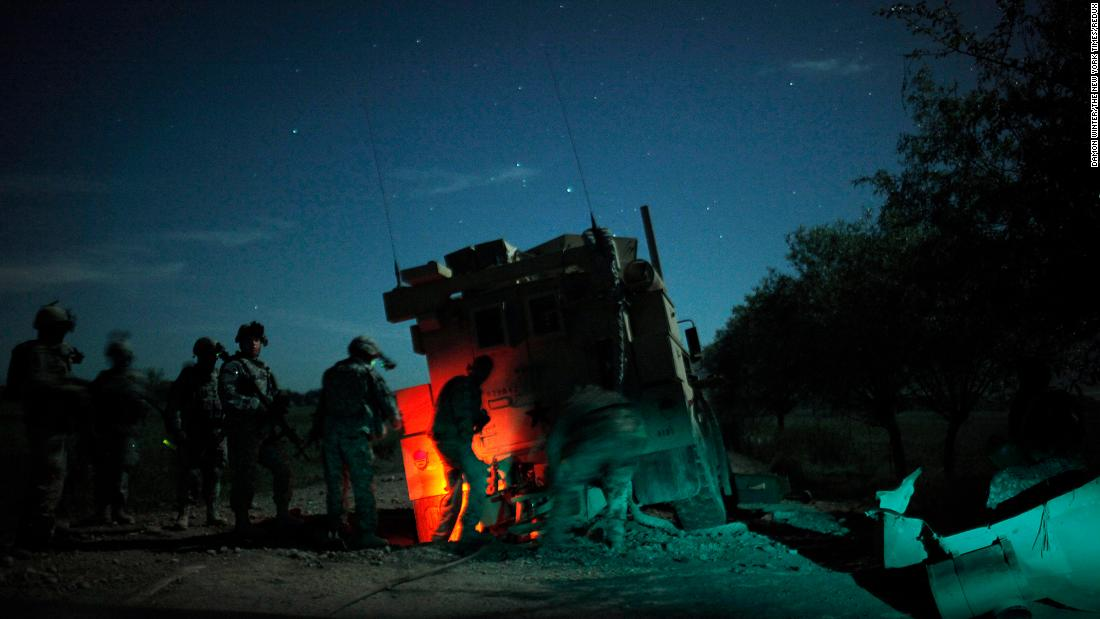 US soldiers recover an armored vehicle that was hit by an explosive device in Afghanistan's Kunduz province in April 2010.