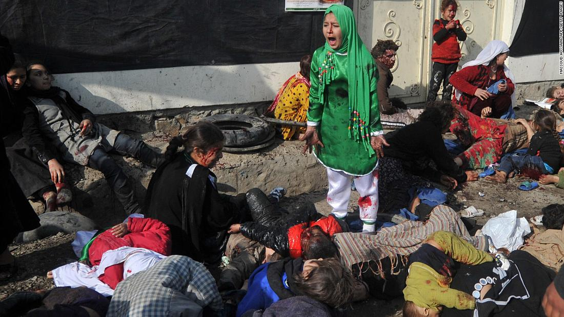 "Tarana Akbari, 12, screams after a suicide bomber attacked the Abul Fazel Shrine in Kabul, Afghanistan, in December 2011. <a href=""https://www.cnn.com/2011/12/06/world/asia/afghanistan-violence-analysis/index.html"" target=""_blank"">Twin bomb blasts</a> killed dozens of Afghan people on the holy day of Ashura."