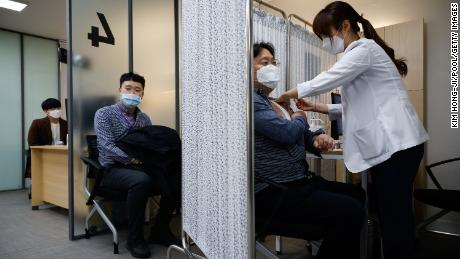 Participants take part in a mock Covid-19 vaccination drill in Seoul, South Korea.