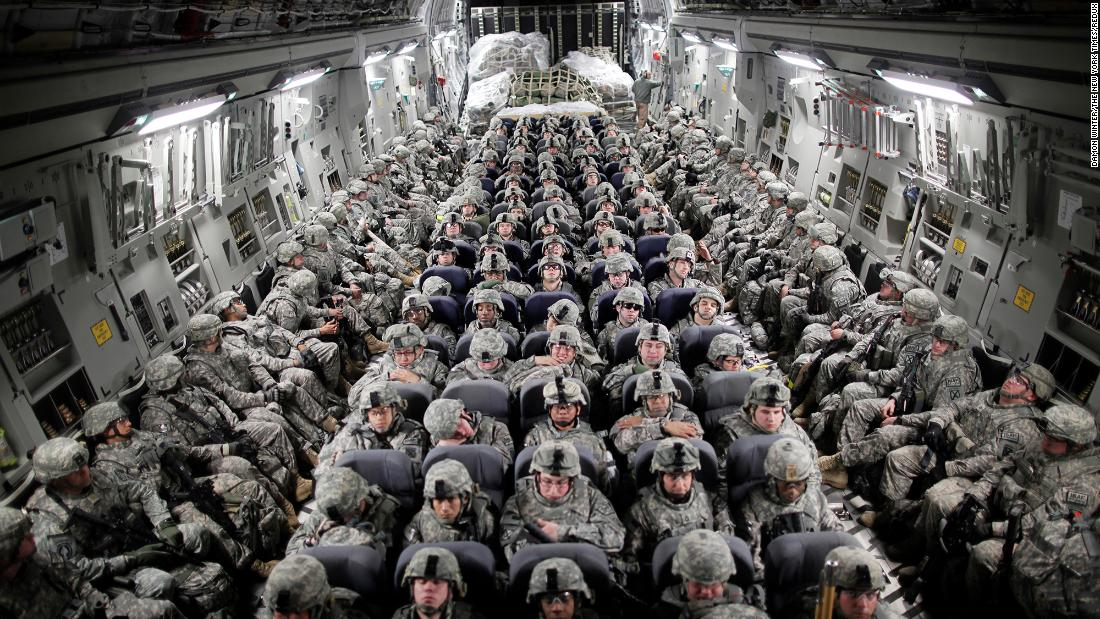 US troops, aboard a C-17 transport plane, head to Afghanistan in April 2010.
