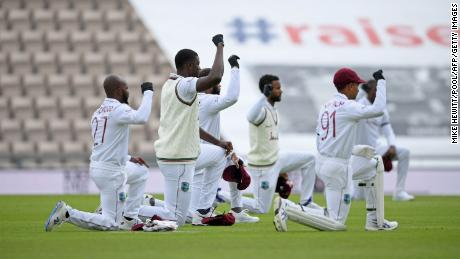 West Indies players take a knee in support of the Black Lives Matter movement ahead of play on the first day of the first Test cricket match against England.
