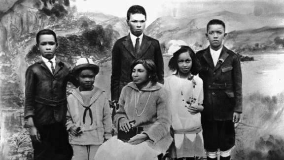 Robinson, second from left, poses with his siblings and his mother, Mallie, for a family portrait circa 1925. Robinson was born in Cairo, Georgia, but raised in Pasadena, California.