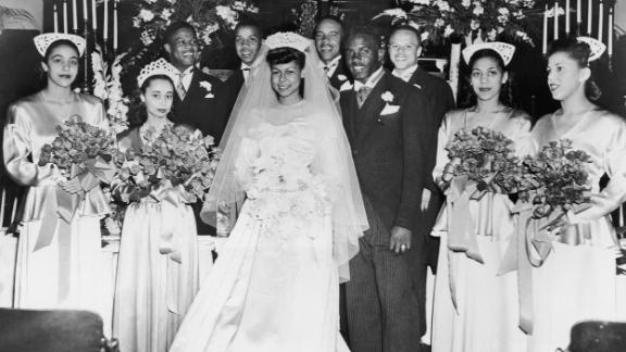 """Robinson married Rachel Isum in Los Angeles in 1946. Throughout his life, she was his partner and sounding board, <a href=""""https://www.cnn.com/2016/04/08/entertainment/jackie-robinson-ken-burns-feat"""" target=""""_blank"""">a steady companion</a> when he was the subject of criticism and worse."""