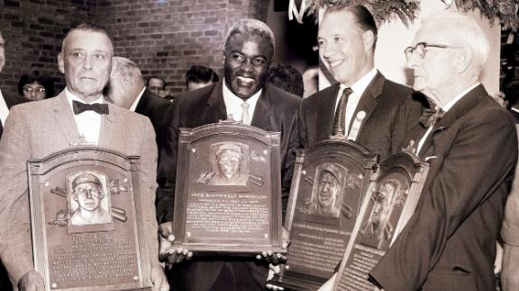 From left, Edd Roush, Robinson, Bob Feller and Bill McKechnie stand with their plaques after being inducted to the Hall of Fame in 1962.