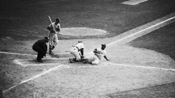 Robinson steals home during Game 1 of the 1955 World Series. The Dodgers lost the game but went on to defeat the New York Yankees in seven games.
