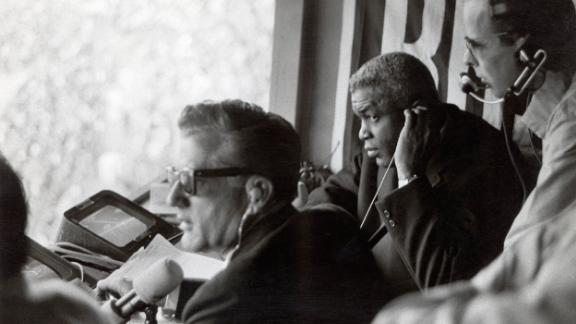 Robinson works in the broadcast booth during the 1960s.