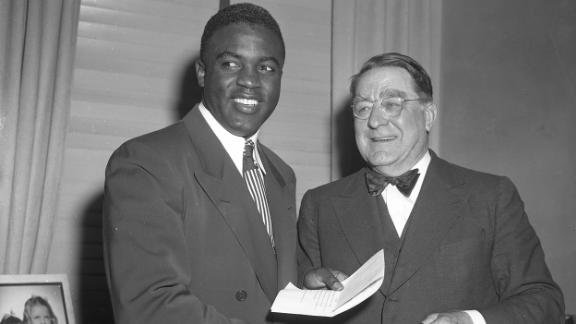 """Dodgers executive Branch Rickey was integral in bringing Robinson to the majors. Rickey had been scouting players who could break the color barrier, and he was looking for someone who would be able to endure the racial hatred and not lash out in anger. """"Are you looking for a Negro who is afraid to fight back?"""" Robinson reportedly said. Rickey responded that he was looking for someone who had <a href=""""https://bleacherreport.com/articles/378888-guts-enough-not-to-fight-back-the-enduring-legacy-of-jackie-robinson"""" target=""""_blank"""" target=""""_blank"""">""""the guts not to fight back.""""</a>"""