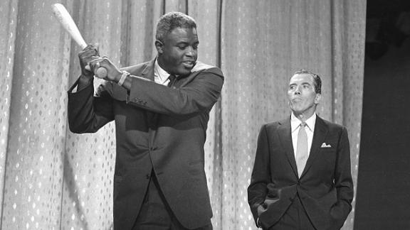 """Robinson appears on """"The Ed Sullivan Show"""" in 1962. After retiring, Robinson became an executive for the Chock Full o'Nuts coffee company. He also spoke out on civil rights."""