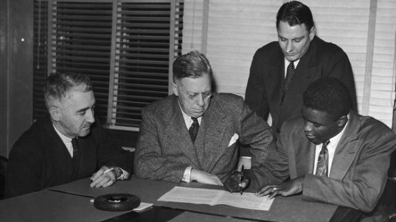 Robinson signs a contract with the Montreal Royals, a minor-league team and farm team of the Brooklyn Dodgers, in 1945.