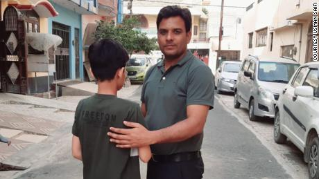 """Bittu,"" 12, with his foster father and legal guardian, Usman Saifi."