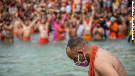 A Sadhu wearing a face mask takes a sacred dip in the Ganges River during the Kumbh Mela Festival in Haridwar, India, on April 12th.