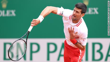 Djokovic in action during his quarterfinal match against Evans.
