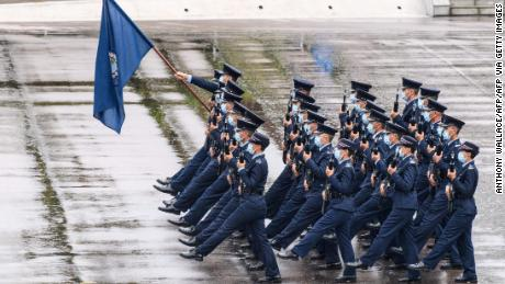 Police officers perform a new goose-stepping march, the same style used by police and troops on the Chinese mainland, at the city's police college during an open day to mark the National Security Education Day in Hong Kong on April 15, 2021.