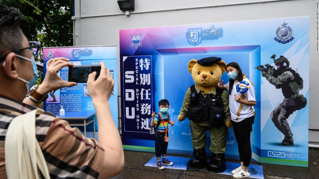 Hong Kong marks National Security Education Day with goose-stepping police and souvenirs